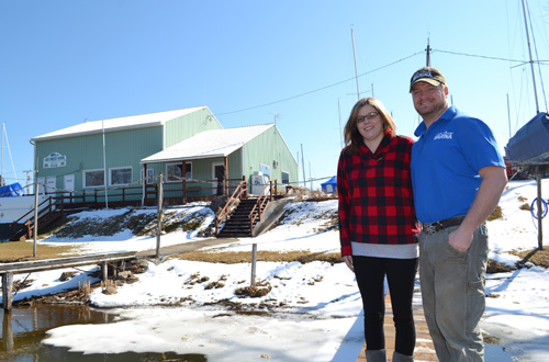Photos by Tom Rivers Gatlen Ernst and his fiancé Danielle Daniels are pictured on a dock in front of Ernst's Lake Breeze marina. Ernst closed on the property last Thursday, acquiring the business from Doug and Janice Bennett.