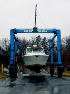 A boat owned by Bob Stevens of Medina is launched into Oak Orchard River Friday afternoon. The boat was stored at Lake Breeze Marina over the winter, which changed ownership earlier this year when 10-year employee Gatlen Ernst bought it from long-time owners Doug and Jan Bennett.